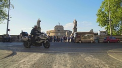 Urban life, motorcyclists riding past Mausoleum of Hadrian in Rome, tourism Stock Footage