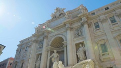 Sunny day in Rome, antique architecture of Trevi fountain, touristic sight Stock Footage