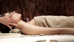 Woman relaxing in spa face massage Stock Footage