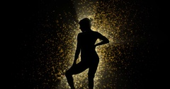 Silhouette dancer with particles 4k Stock Footage