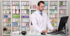 Pharmacist Man Talk Phone Customer Health Care Lack of Medicine Pharmacy Store Stock Footage