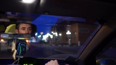 Young man is driving the car, in the rear view mirror reflected his face. 4K Stock Footage
