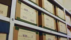 Court and police evidence archive racks with boxes. Tilting down. Stock Footage