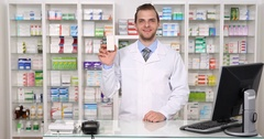 Pharmacist Man Smile Show Medicament Drugs Hand Gestures Ok Sign Pharmacy Store Stock Footage