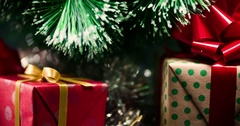 Decorated Christmas tree with gifts box rotation 4k extreme close-up loop video Stock Footage