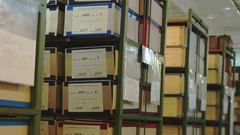 Court and police evidence archive. Real racks with boxes. Tilting down. Stock Footage