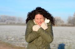Attractive young woman shivering Stock Photos