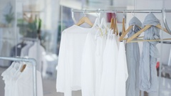 4K Interior of fashionable women's clothes store with clothes racks & mannequins Stock Footage