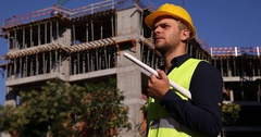 Architect Expert Engineer Blueprint Plan Looking Out Under Construction Building Stock Footage