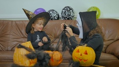 Woman in scary mask fool with girl on Helloween Stock Footage
