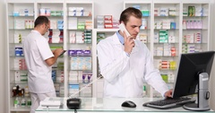 Pharmacist Man Talk Phone Client Pharmacy Activity Team Work Cooperation Concept Stock Footage