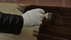 Painting of wooden board by person Stock Footage