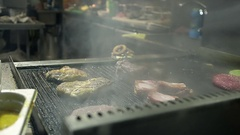 Close Up of a Chef Preparing a Succulent Steak on the Stove in Restaurant Stock Footage
