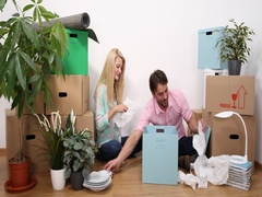 Young Home Owner Couple Moving Out Packing Ceramics in a New Home Property Move Stock Footage