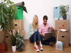 Beautiful Couple Buying with Credit Card Using Laptop for New House Living Room Stock Footage