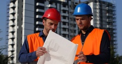 Engineers Teamwork Holding Plans and Talking Under Development Site Handshaking Stock Footage