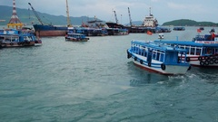 Tourist and fishing boats in the harbor. Stock Footage