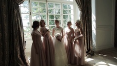 Bridesmaids in dresses laugh happy near bride at bachelorette party slow motion Stock Footage
