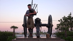 Man in Kilt Playing Bagpipes at Sunset in Jackson Square, New Orleans Stock Footage