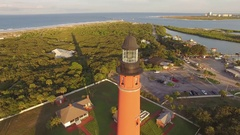180 degree wrap around lighthouse flight revealing Florida pristine beach Stock Footage