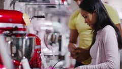 4K Couple shopping in a store selling kitchen appliances Arkistovideo
