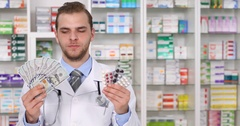 Pharmacist Man Show Us Dollars Expensive Medicine Pills Pharmacy Store Concept Stock Footage