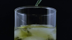 Macro three drops green liquid added to beverage Stock Footage