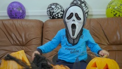 Boyin terrible mask try to scary on Halloween Stock Footage