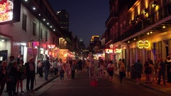 Bourbon Street at Night in The French Quarter of New Orleans, Louisiana Stock Footage