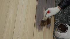 Painting of wooden plank by human hand Stock Footage
