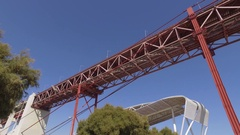 Suspension bridge 25 de arril over the tagus river in lisbon, steady gimbal 4k Stock Footage