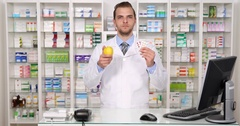 Pharmacist Man Showing Medicine vs Apple Fruit Pharmacy Store Own Choose Concept Stock Footage