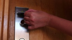 Woman opens the door with the key card Stock Footage