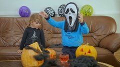 Little boy in scream mask are scaring on Halloween Stock Footage