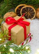 Christmas gift with luminous lights. Stock Photos