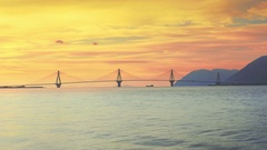 Beautiful wide view suspension bridge landmark famous Rio Antirrio sky sunset Stock Footage