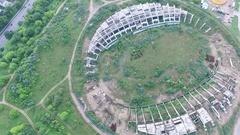 Flight Around Abandoned Stadium Near Supermarket 2 Stock Footage