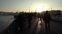 Slow motion people walking on the Galata Bridge in Istanbul Turkey (Editorial) Arkistovideo