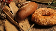 Rustic rolls and breads, with cereals on the table, close up Stock Footage