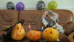 Little cute boy are fooling on the Halloween party Stock Footage