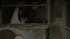 Entourage of first World War - officer and nurse keeping hands of each other Stock Footage
