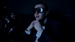 Young funny man watching a 3D movie in cinema Stock Footage