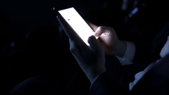Male hands with a touchscreen in cinema Stock Footage