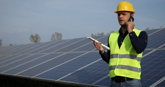 Engineer Man Talking Mobile Phone on Clean Electricity Production Solar Panels Stock Footage