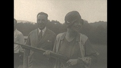 Vintage 16mm film, 1928 woman aims gun at camera, reckless Stock Footage