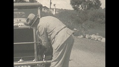 Vintage 16mm film, 1928 man polishing car, Massachusetts license plate Stock Footage