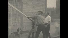 Vintage 16mm film, 1928 fire hose tripod demonstration, mechanical Stock Footage