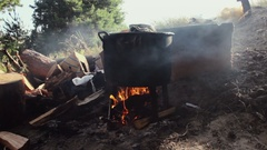 Cooking outdoors in cast-iron cauldron. Stock Footage