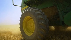 The season of harvest. Harvester in the wheat fields produce hay. Stock Footage