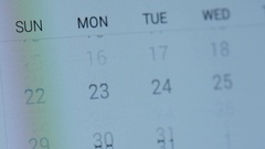 Flipping through calendar on tablet screen 4k Stock Footage